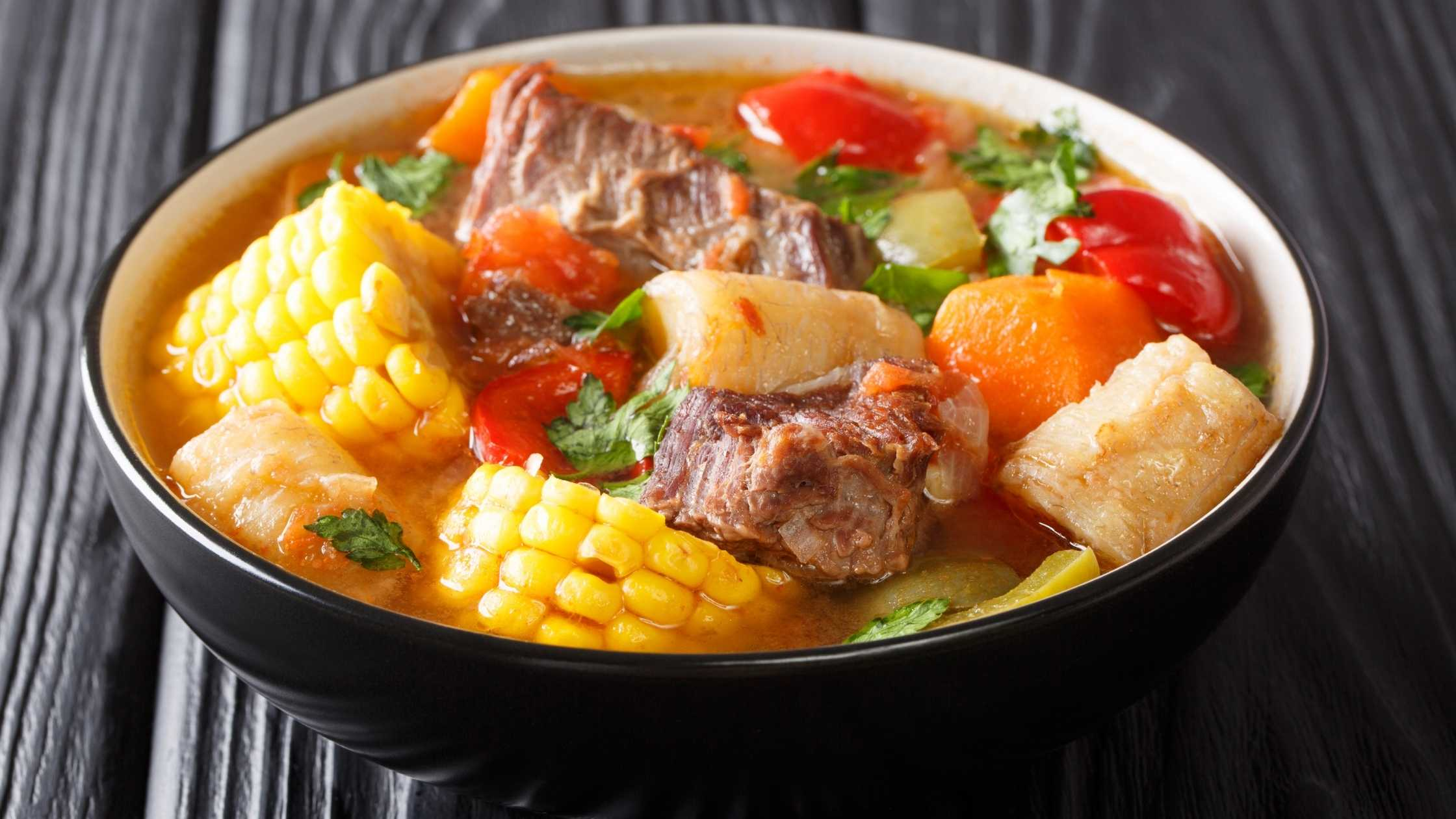 Sancocho soup dish in a black bowl
