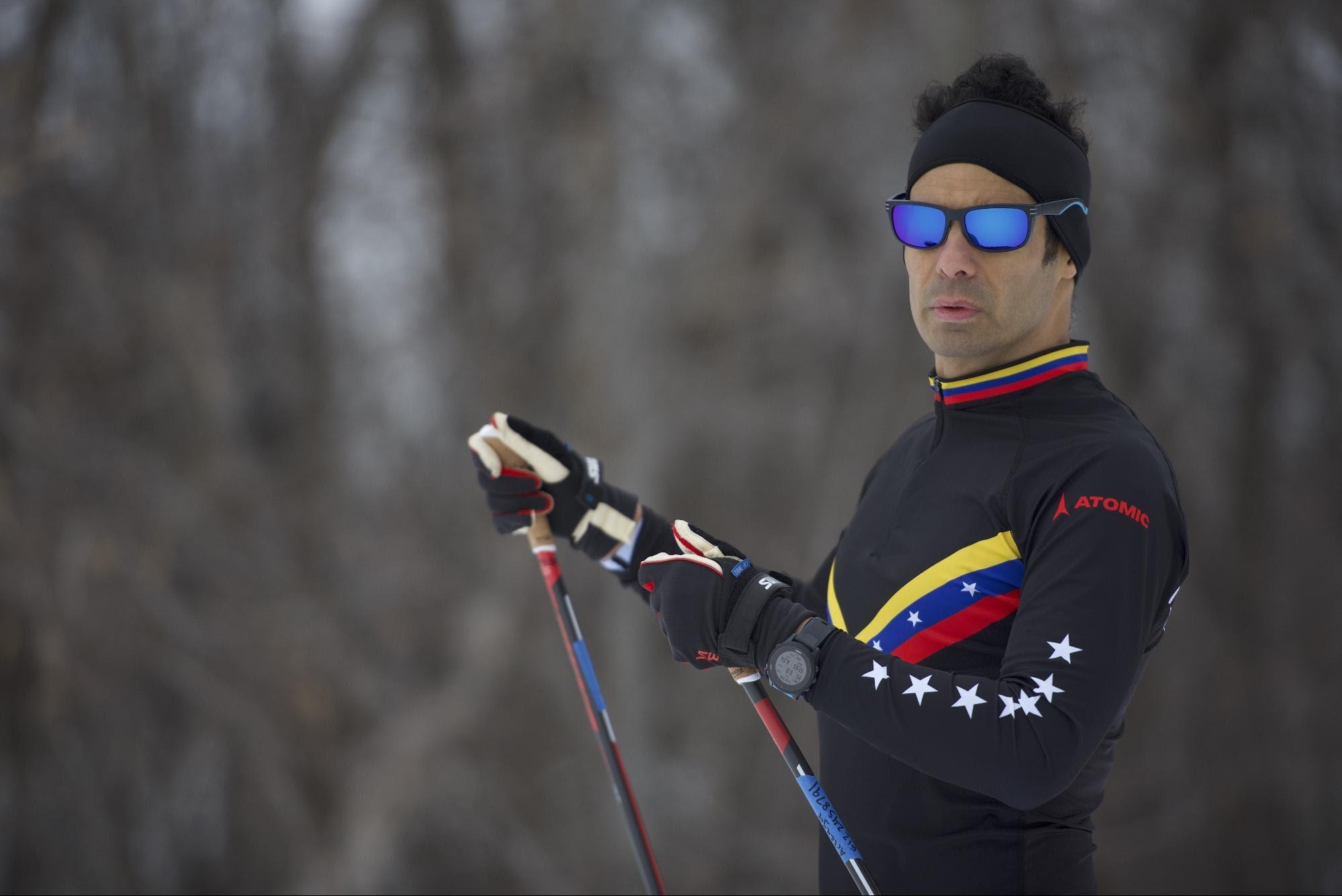 Eduardo Arteaga wearing black ski outfit with Venezuela flag print